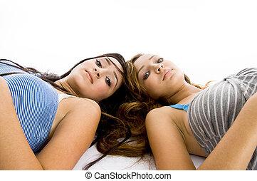 laying girls looking at camera