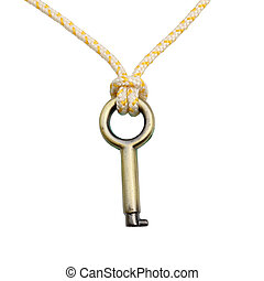 A Brass key hanging by a thread isolated over white background