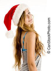 cute teenager girl wearing christmas hat - side pose of cute...