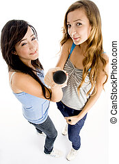 high angle view of girls holding microphone - high angle...