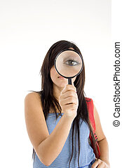 magnifying eye of girl - magnifying eye of young girl...