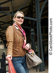 Portrait of middle aged woman smiling outdoors