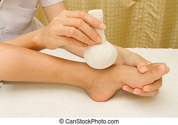 Children massage foot with herbal compress balls - Children...
