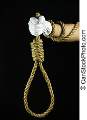 Hand in a white glove holding a noose to the gallows