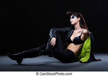 Fashion Ultramodern Glamorous Woman sitting in Modern...