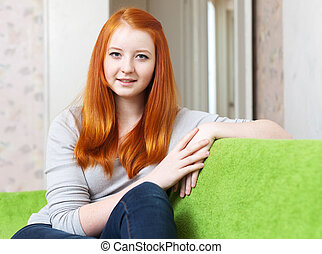 tenager girl in home interior - ordinary red-haired tenager...