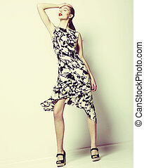 Fashionable Young woman wearing Spotted Dress. Smart Casual...