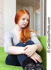 lonely teenager girl on sofa
