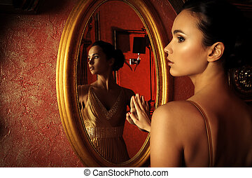 good posture - Beautiful young woman in a luxurious classic...