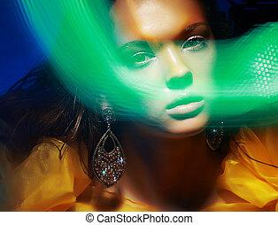 Diffuse. Fantasy. Silhouette of Woman's Face in Magic Disco...