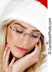 close up of female in christmas hat wearing eyeglasses with...