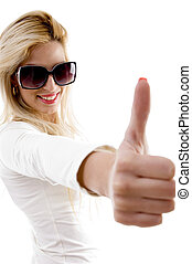 side view of smiling model with thumbs up