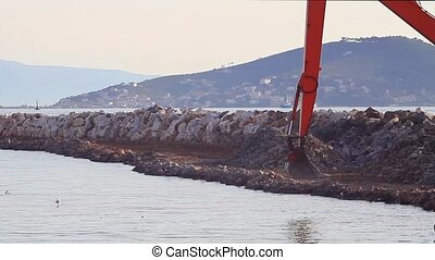 Telescopic arm of crawler excavator - Land reclamation site....