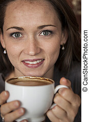 Young Woman with Beautiful Green Eyes with White Coffee Cup...