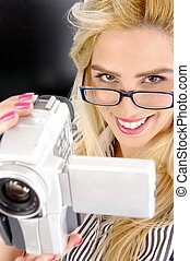 side pose of female holding video camera
