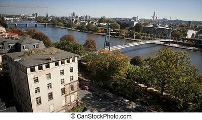 Holbeinsteg Bridge in Frankfurt - People walk through...