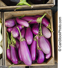 Organic Asian Eggplants - A wooden crate full of beautiful...