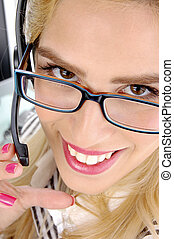 close up view of smiling telecaller in an office