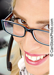 close view of smiling customer care provider in an office