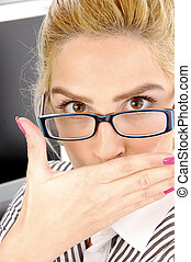 close view of surprised businesswoman in an office