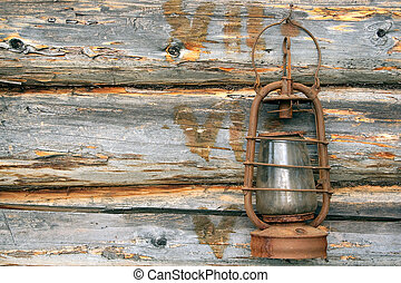 Old Lamp - Antique kerosene lamp on the background wall of a...