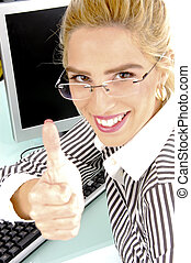 side view of smiling woman with thumbs up