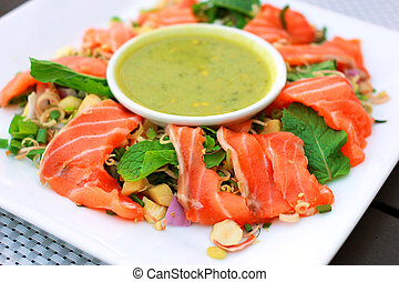 Spicy salmon salad with wasabi sauce