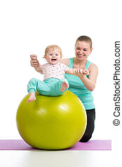 mother doing gymnastics with baby  on fitness ball