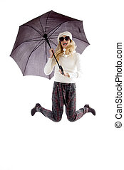 front view of jumping woman holding an umbrella