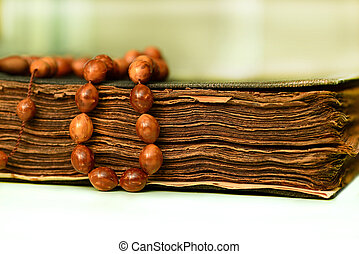 Muslim rosary on the koran - An ancient hand scripted Quran...