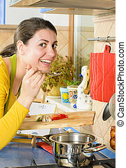 Life in the Kitchen - Beautiful smiling woman preparing...