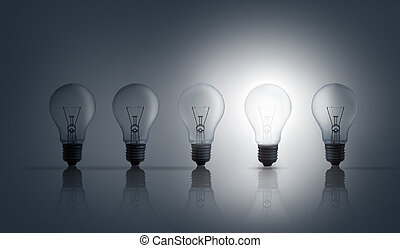 Five light bulbs in row against grey background