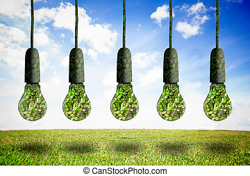 Five light bulbs hanging in the air with plants inside