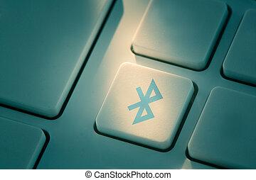 Blue bluetooth button on keyboard
