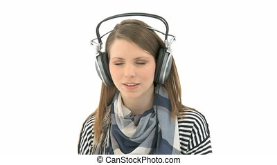 Woman listens to music - Beautiful woman listening to music...