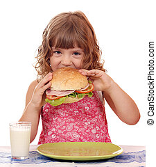 hungry little girl eating sandwich