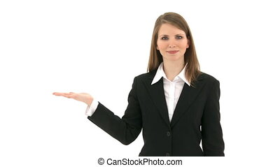 Woman presenting something on her hand - Woman stands in...
