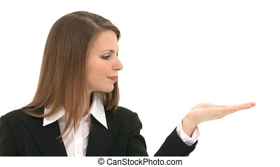 Woman blows something from her hand