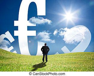 Businessman looking at euro signs o - Businessman looking at...
