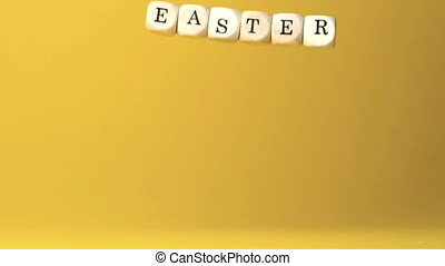 Dice spelling out easter falling ag