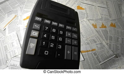 Big calculator falling and bouncing on papers with numbers...