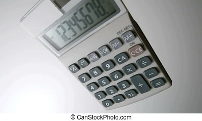 Pocket calculator falling on white - Pocket calculator...