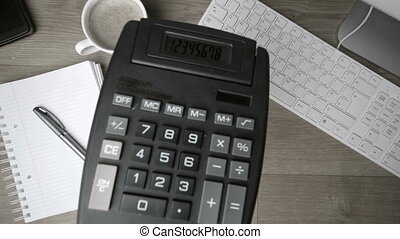 Calculator falling on office desk i