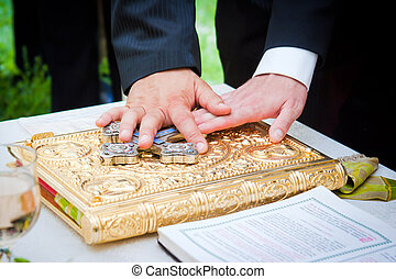 Hands on bible at a wedding ceremony