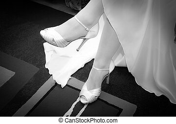Bride legs with high heels shoes