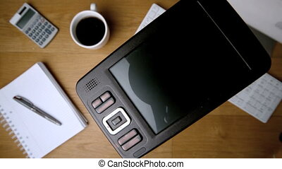 Smartphone falling onto office desk beside computer coffee...