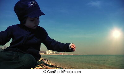 Little boy playing on the sea shore