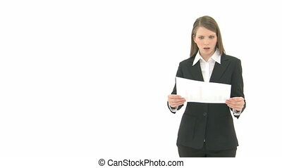 Woman breaks paper - Young woman in anger breaks a sheet of...