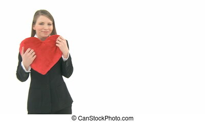Woman cuddling with a heart pillow - Woman comes into the...