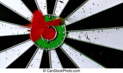 Dart htting dart board in slow motion